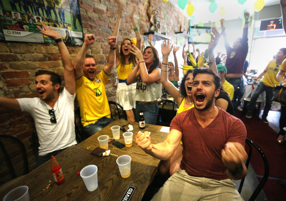Denis Santos celebrates as his team Brazil scores the second goal against Croatia in the first half of the World Cup 2014 at the Brazilian Bar and Grill