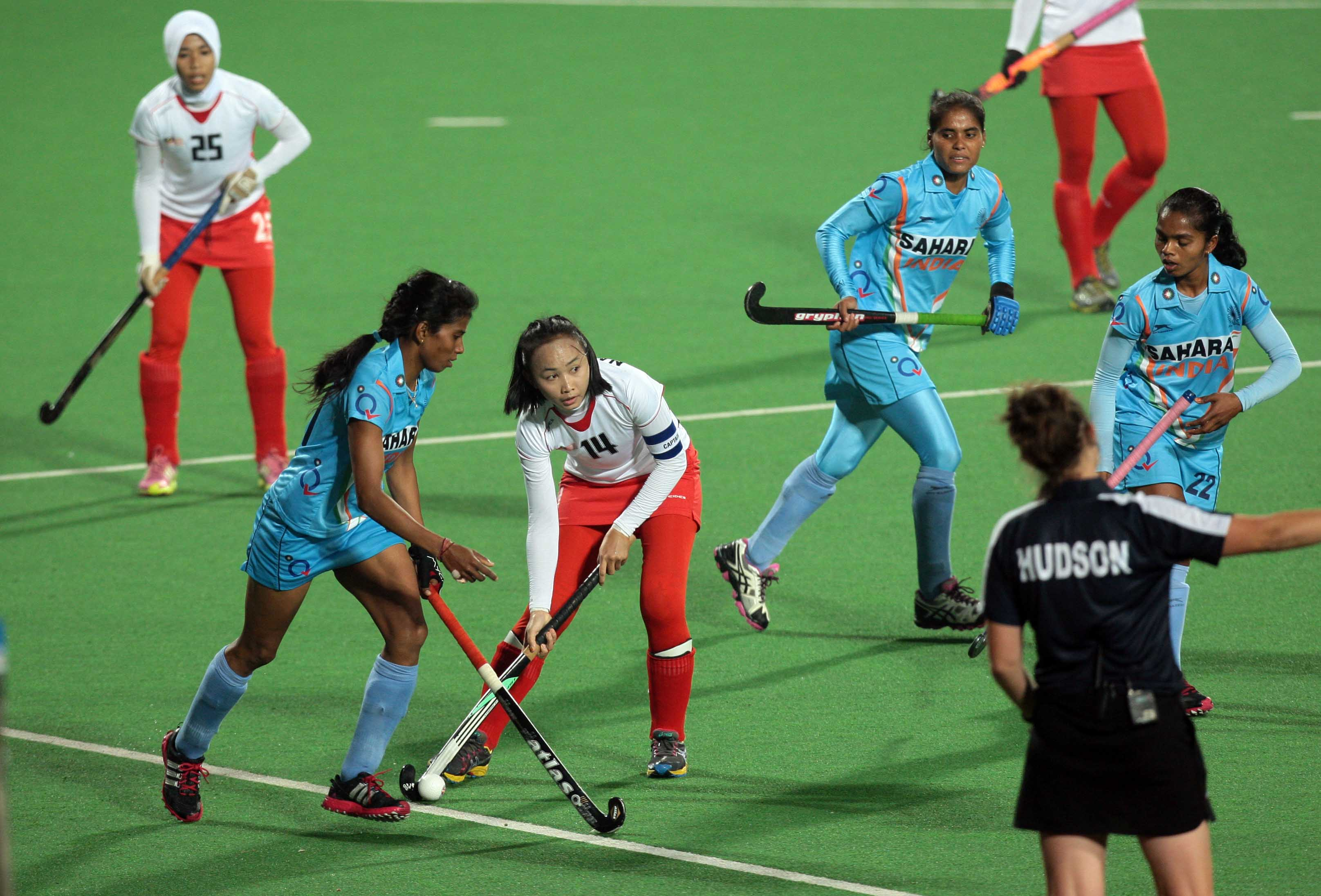 Hero-Hockey-World-League-2013-Yendala-Soundarya-of-India-in-action-against-Abdul-Rahman-Nadia-of-Malaysia-at-Delhi-on-19th-Feb-2013-1-1335220